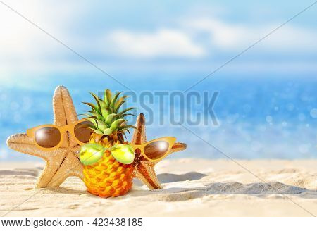 Pineapple And Starfish With Sunglasses In The Beach. Summer Concept.