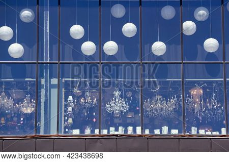 Shop Lighting Showcase With Chandeliers. Street View Of The Window. An Assortment Of Chandeliers Of
