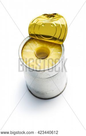 Canned sliced pineapple fruit in can isolated on a white background.