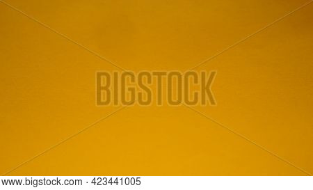 Yellow Vivid Abstract Background. A Beautiful Rich Yellow Color Close To Ocher