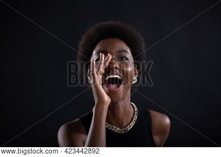 Portrait Of Black African American Woman Holding Palm Hand Near Wide Open Mouth Yelling Screaming Sh