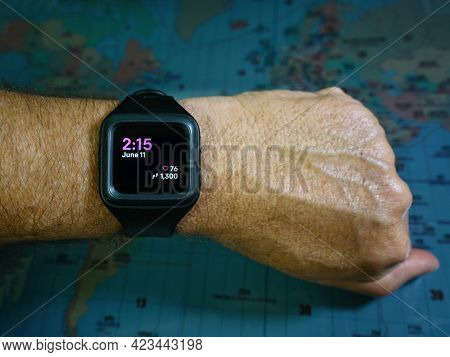 Fitness Watch On Mans Forearm Showing Date, Time, Heart Rate And Step Counter.
