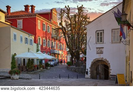 Motovun town, Istria, Croatia. Comfy street and square with picturesque architecture and old houses during evening sunset. Famous touristic travel destination and romantic place.