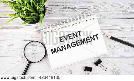 Event Management Text Concept Write On Notebook With Office Tools On Wooden Background