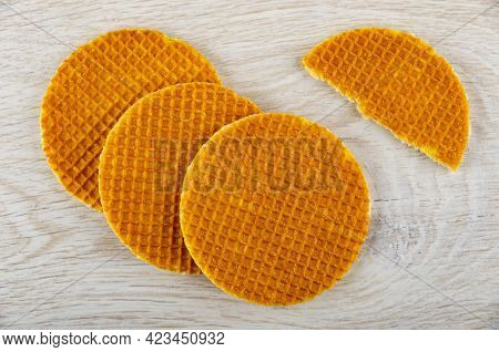 Three Round Wafers With Filling, Half Of Wafer On Wooden Table. Top View