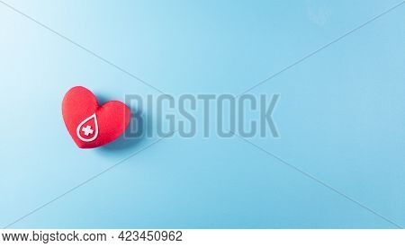Medical And Donor Concepts. A Handmade Red Heart With A Sign Or Symbol Of Blood Donation For World B