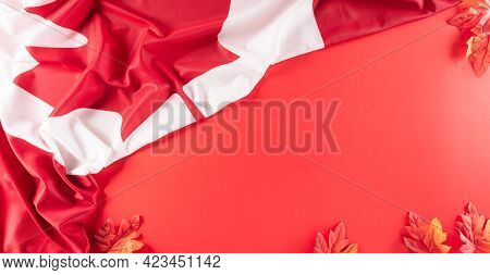 A Beautiful Canada National Flag Cloth Fabric With Red Silk Maple Leaves, A Sign Or Symbol Of Canada