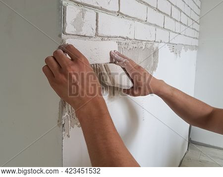Laying Gypsum Tiles In Rows On The Wall With Male Hands.