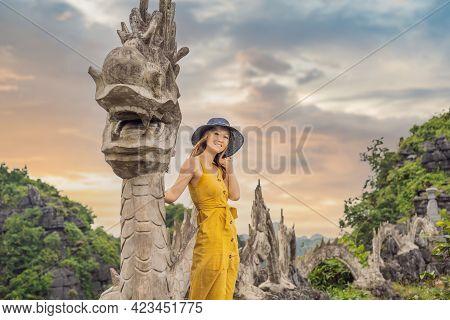 Woman Tourist On Background Of Amazing Huge Dragon Statue At Limestone Mountain Top Near Hang Mua Vi