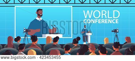 Businessman Giving Speech At Tribune With Microphone On Corporate International World Conference