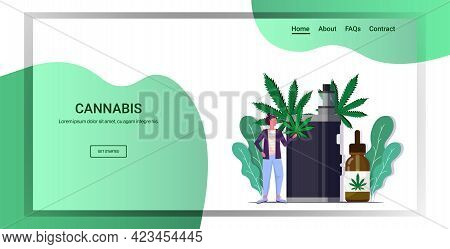 Woman Holding Cannabis Leaf Using Vaporizer E-cigarette Cbd Vaping Drug Consumption Concept Marijuan