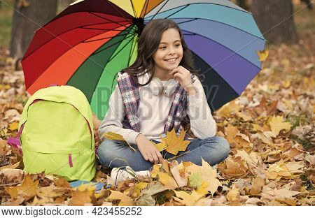 Snapping Memories. Enjoy Warm Seasonal Weather. Happy Kid Sitting Under Colorful Umbrella. Girl With