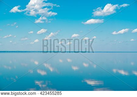 Cloudscape. Clouds In The Blue Sky And Reflection In A Large Lake. Big Beautiful Clouds In The Morni