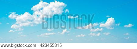 Amazing Cloud Formations On A Bright Blue Sky. Beautiful Side Lit Cloudscape Panorama In Springtime.
