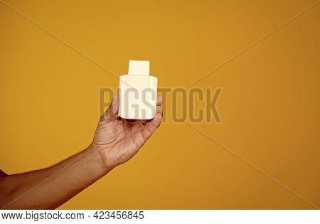 Vitamin For Immune Bolstering. Blank Drug Bottle In Male Hand. Vitamin D Supplement. Prevent Infecti