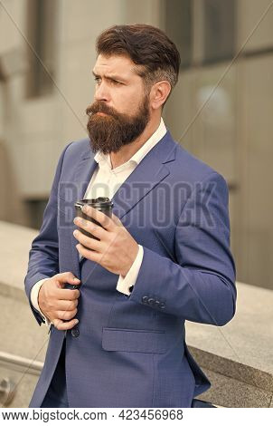 Brutal Hipster With Brutal Look In Formal Business Suit Drink Coffee Outdoors, Morning