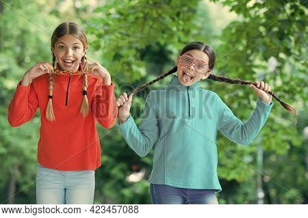 Crazy Things To Do At Party. Happy Children Have Fun Natural Outdoors. Funny Look Of Party Girls. Le