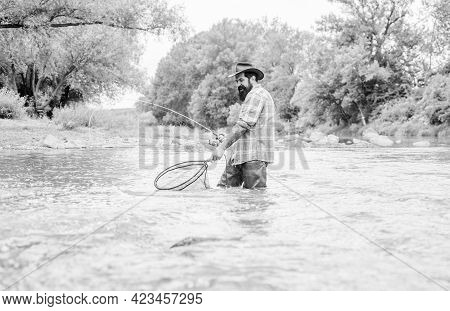 Fishing Is Astonishing Accessible Recreational Outdoor Sport. Fishing Hobby. Bearded Fisher Catching