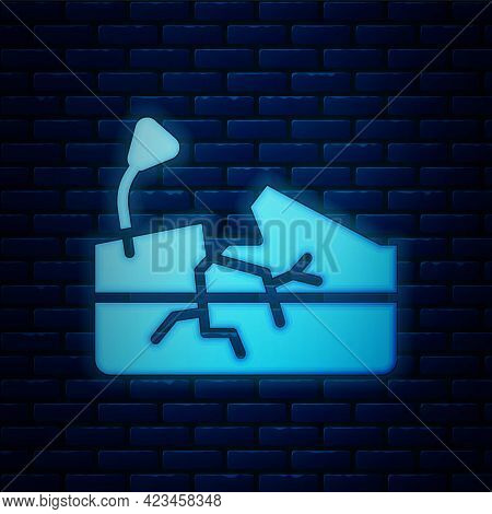 Glowing Neon Earthquake Icon Isolated On Brick Wall Background. Vector