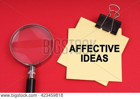 Business And Economics. On A Red Background, A Magnifying Glass And A Sticker With The Inscription -