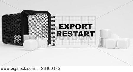 Business And Finance Concept. On The Table Are Cubes, A Small Basket And A Notebook With The Inscrip
