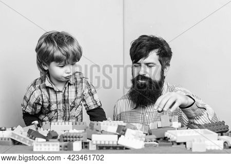 Father Leader Showing Boy How Grow Into Successful Man. Child Care And Upbringing. Father Son Game.