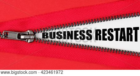 Finance And Business Concept. Against The Background Of Red Fabric, A Zipper Opens, On The White Sur