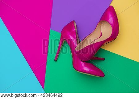 Beautiful Womens Shiny Patent Purple Stiletto Heels On A Colored Background