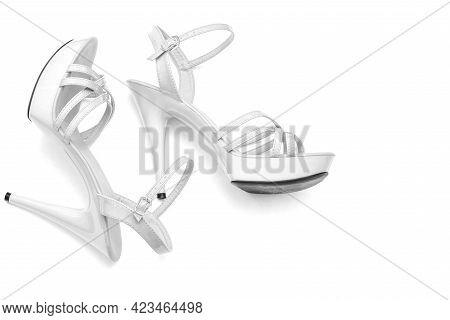 Beautiful Womens Shiny Patent White Stiletto Sandals On A White Background