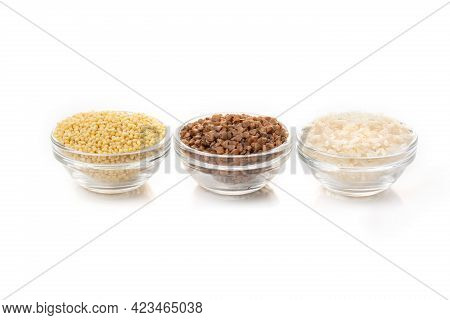 Three Transparent Bowls With Buckwheat, Millet, And White Rice Grains Isolated On A White Background