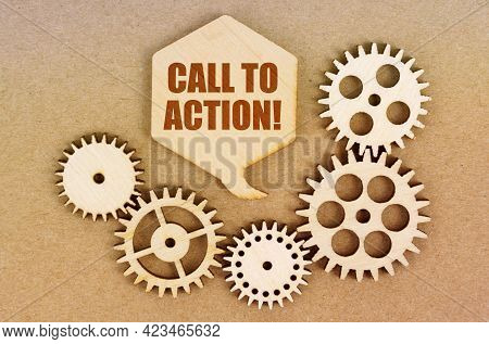 Business And Economics Concept. On A Paper Background, Gears And A Thought Plate With The Inscriptio