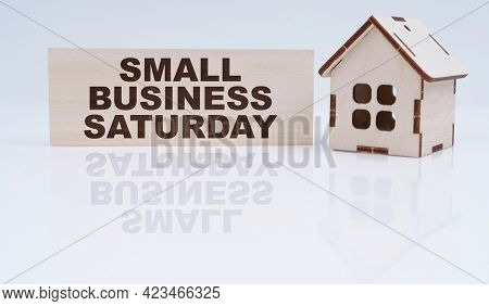 Economy And Business Concept. There Is A Wooden House And A Sign On The Table - Small Business Satur