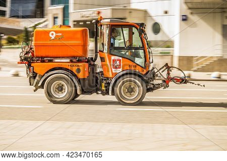 Moscow, Russia - May, 2021: Sweeper Machine On The Road In The City. Community Road Services, Street