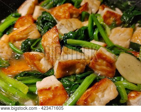 Detail Of Fried Tofu With Chinese Dark Leafy Vegetable Cooked In Tamarind Cause. This Vegetarian Dis