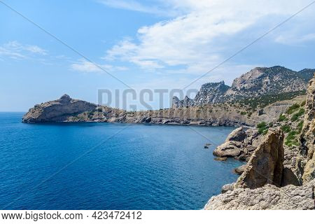Panorama Of Cape Kapchik & Blue Bay. From This Side Shape Of Rock Cape Reminds Dolphin Jumping Out O
