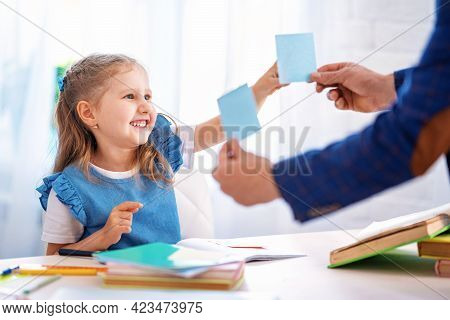 Cute Smart Little Girl Thinks About Answer In The Task. Child Is Taught At Home With A Tutor . Home