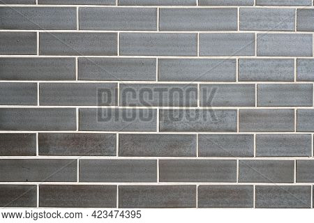 Background From A Wall Made Of Grey Clinker Bricks