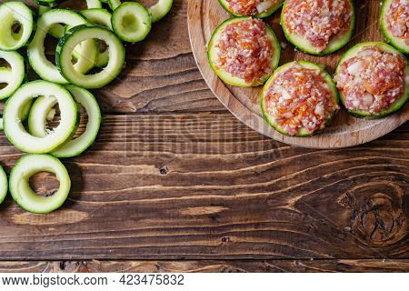 Fresh Green Striped Zucchini Cut Into Circles Prepared For Stuffing With A Mixture Of Meat And Veget