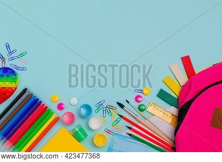 Back To School. Bright Colorful School Supplies And Backpack For School Or College On Blue Backgroun