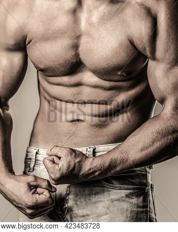 Biceps, Abs And Pecs And Wearing. Muscular Male Strains Muscles And Screams. Muscular Bodybuilder Po