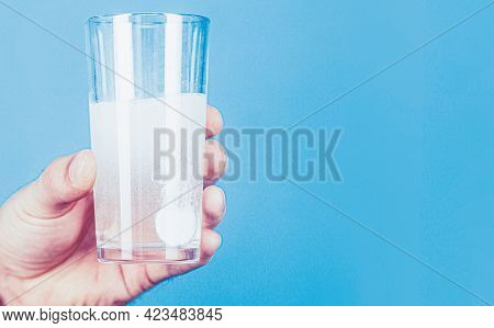 Glass Of Water Tablet. Glass With Efervescent Tablet In Water With Bubbles. White Pill And A Glass O