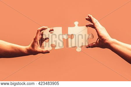 Man Hands Connecting Couple Puzzle Piece. Business Solutions, Target, Success, Goals And Strategy Co
