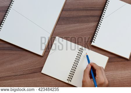 Content Marketing Concept. Top View Of Hand Writing On Open Notebook, Mockup For Advertise Content O