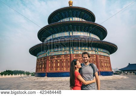 China travel happy couple tourists posing for portrait in front of Temple of Heaven, Beijing city. chinese famous tourist destination in Asia tourism.