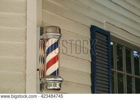Barber Pole On Side Of Barber Shop