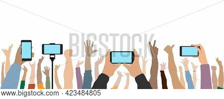 Raised Up Human Hands And Hands Of People With Phones. Cheerful Crowd Of People At Concert Or Party,