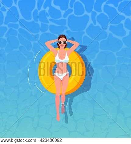Woman Sunbathing Top View. Female Swimming On Inflatable Floats. The Concept Of Vacation And Travel.