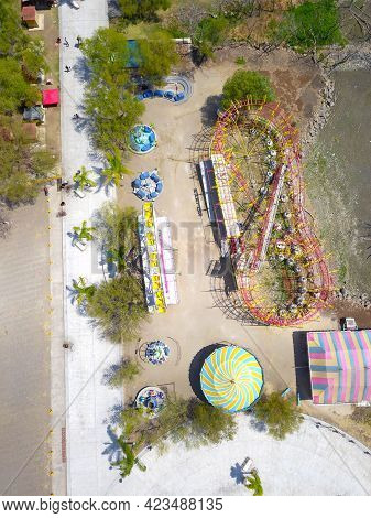 Aerial Overhead View Of Mechanical Games On The Jocotepec Boardwalk, Mexico