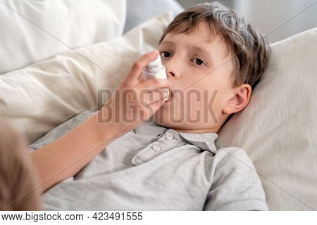 Sick Boy Tired From Chest Coughing Holding Inhaler, Having Asthma Allergy Using The Asthma Inhaler.