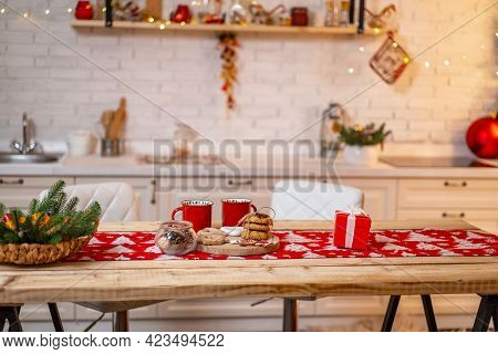 Merry Christmas! Interior Decorated Kitchen With Christmas Decor And Christmas Tree. Table With Hot